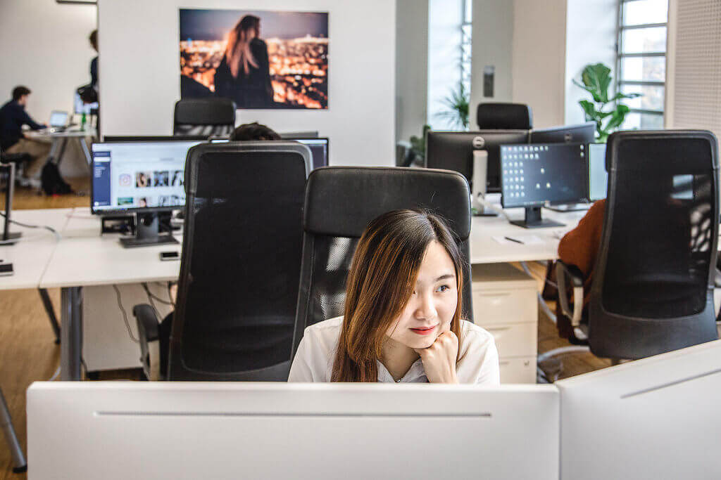 Team members working at the office