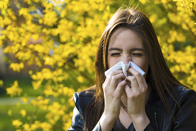 Woman with itchy runny nose
