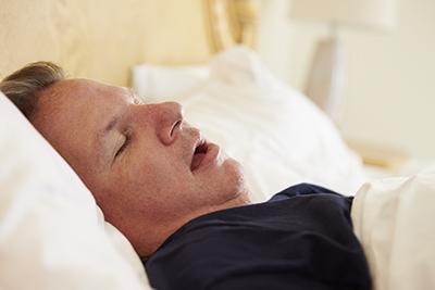 Overweight man sleeping