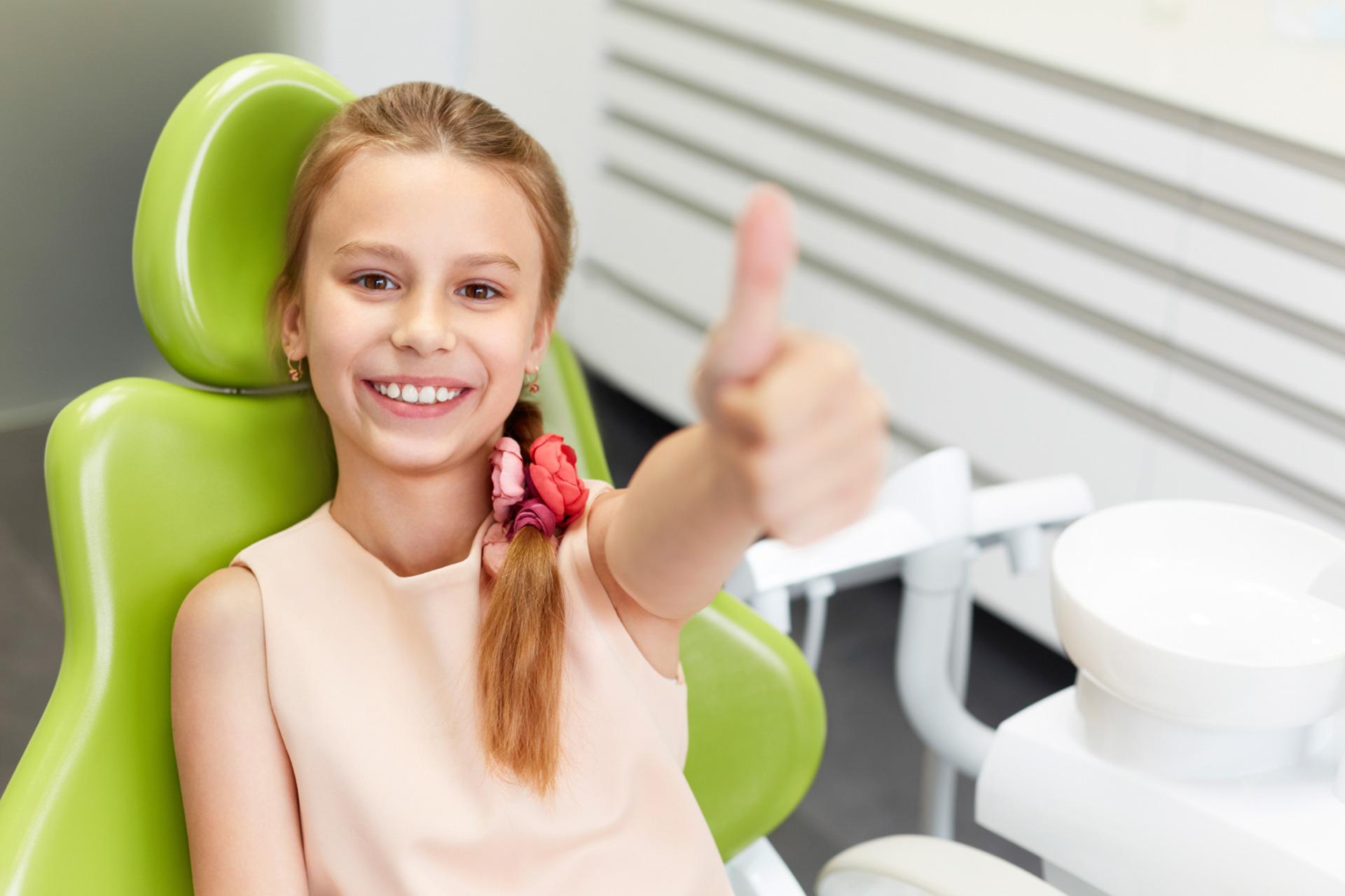 Smiling girl in Dental chair