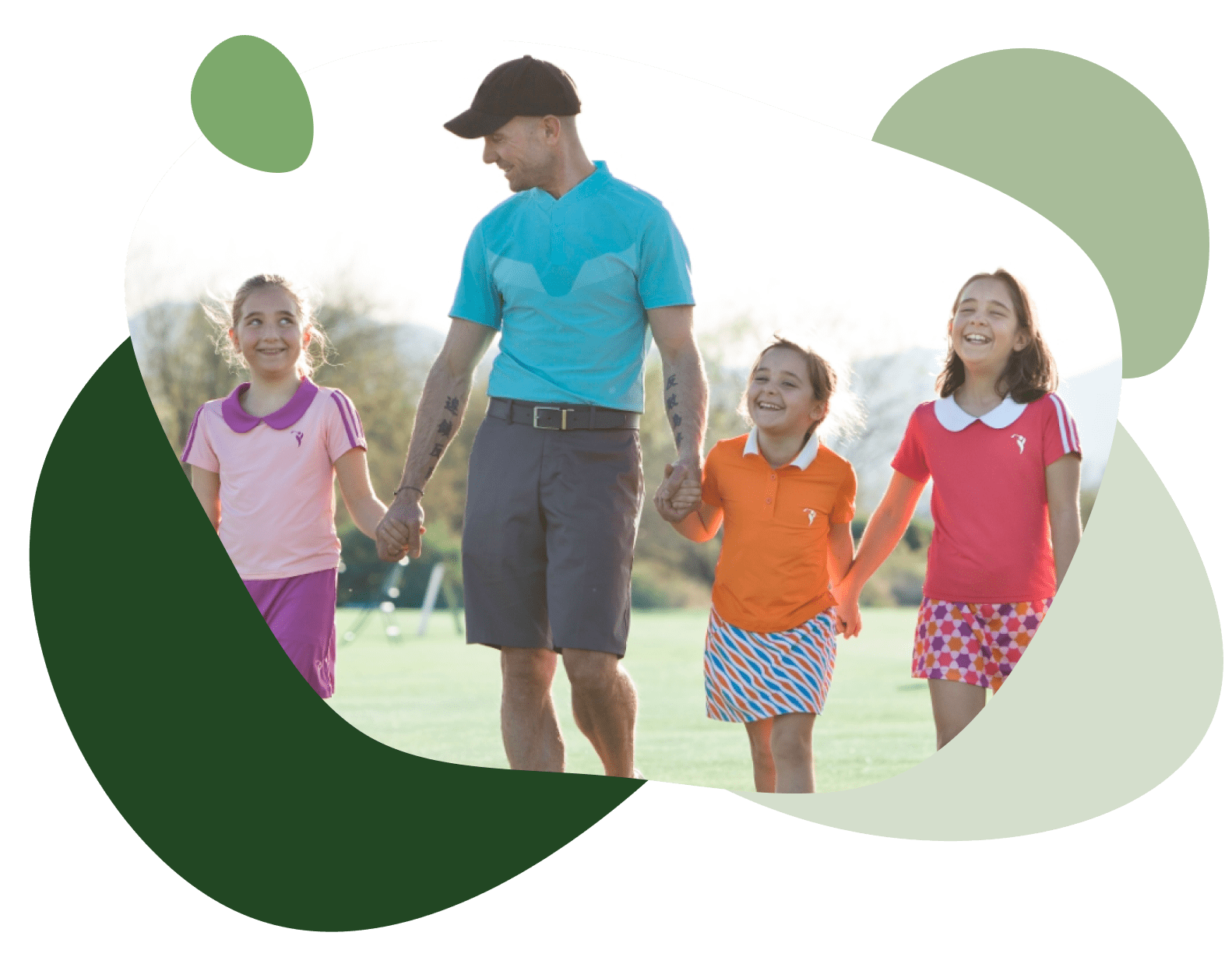 scott petinga on a golf course holding hands with his three smiling daughters wearing wynnr kid's golf clothing brand.