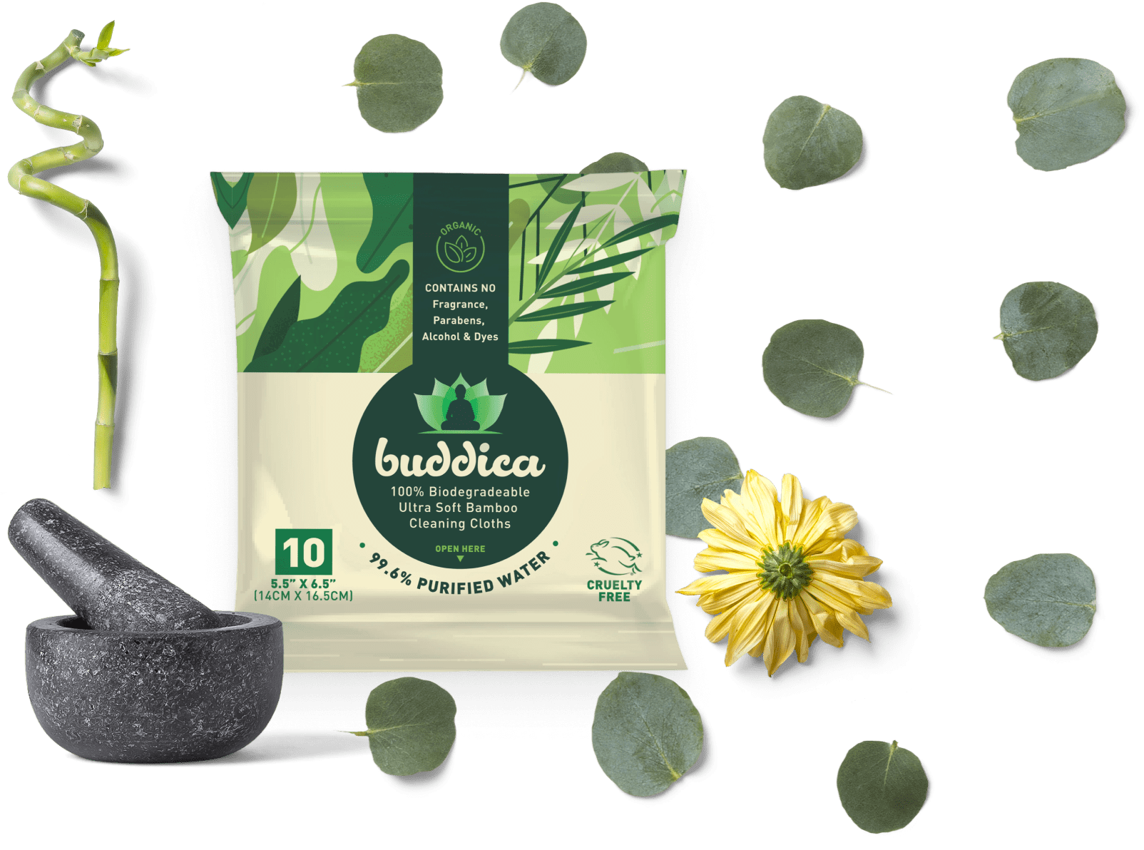 a pack of buddica wipes surrounded by a bamboo stick, scattering of leaves, a yellow flower and mortar and pestle.