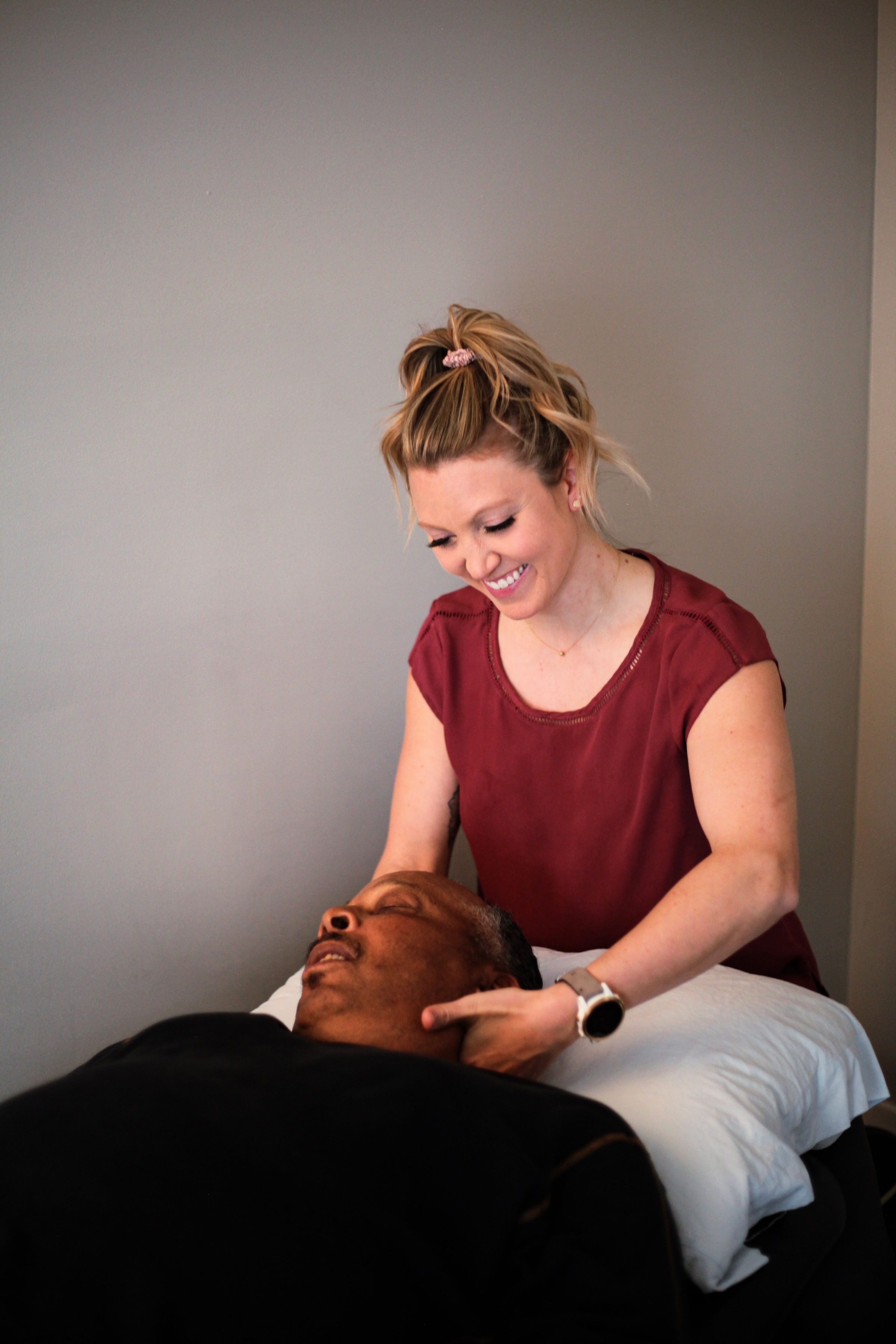 A physical therapist treating a patient.