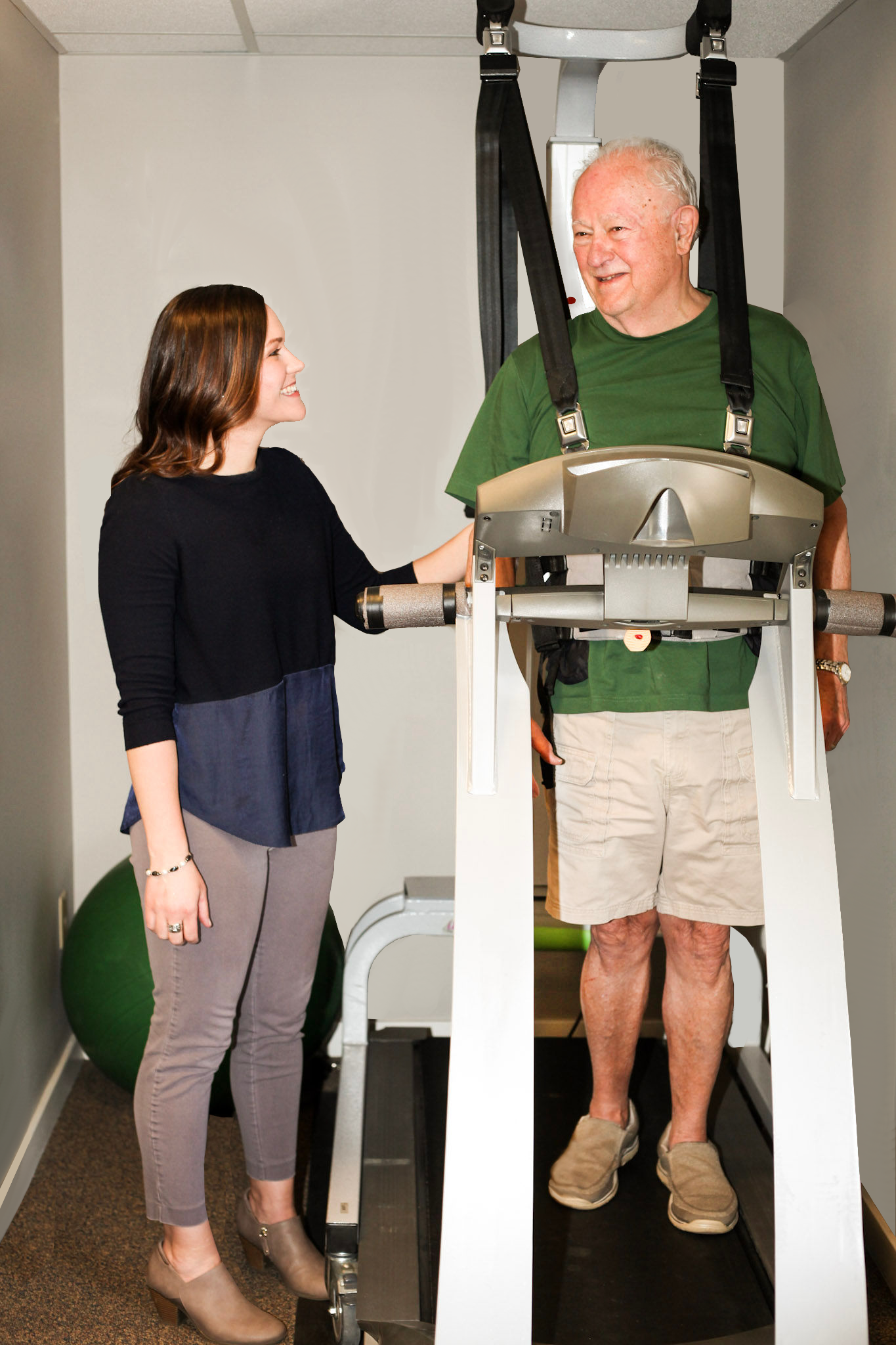 Man being treated on a treadmill.