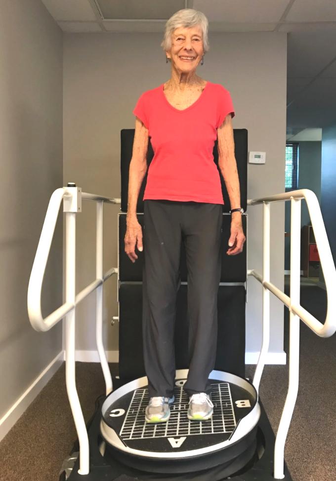Woman standing on a balance machine.