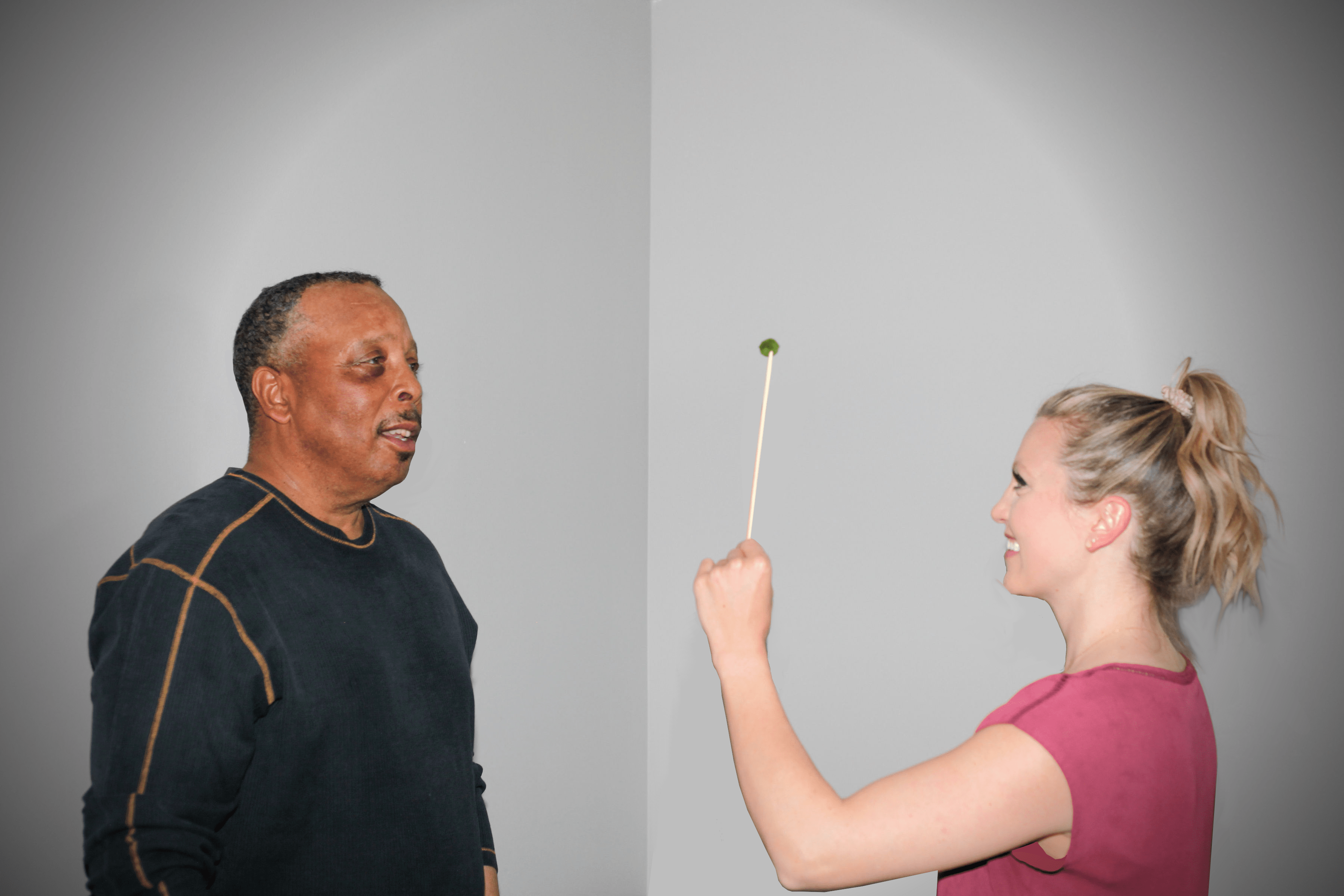 A therapist giving a patient an eye test.