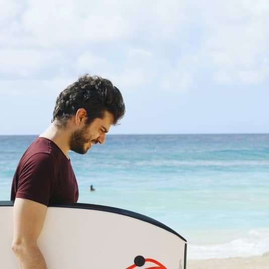 Copywriter man on beach ContentFly