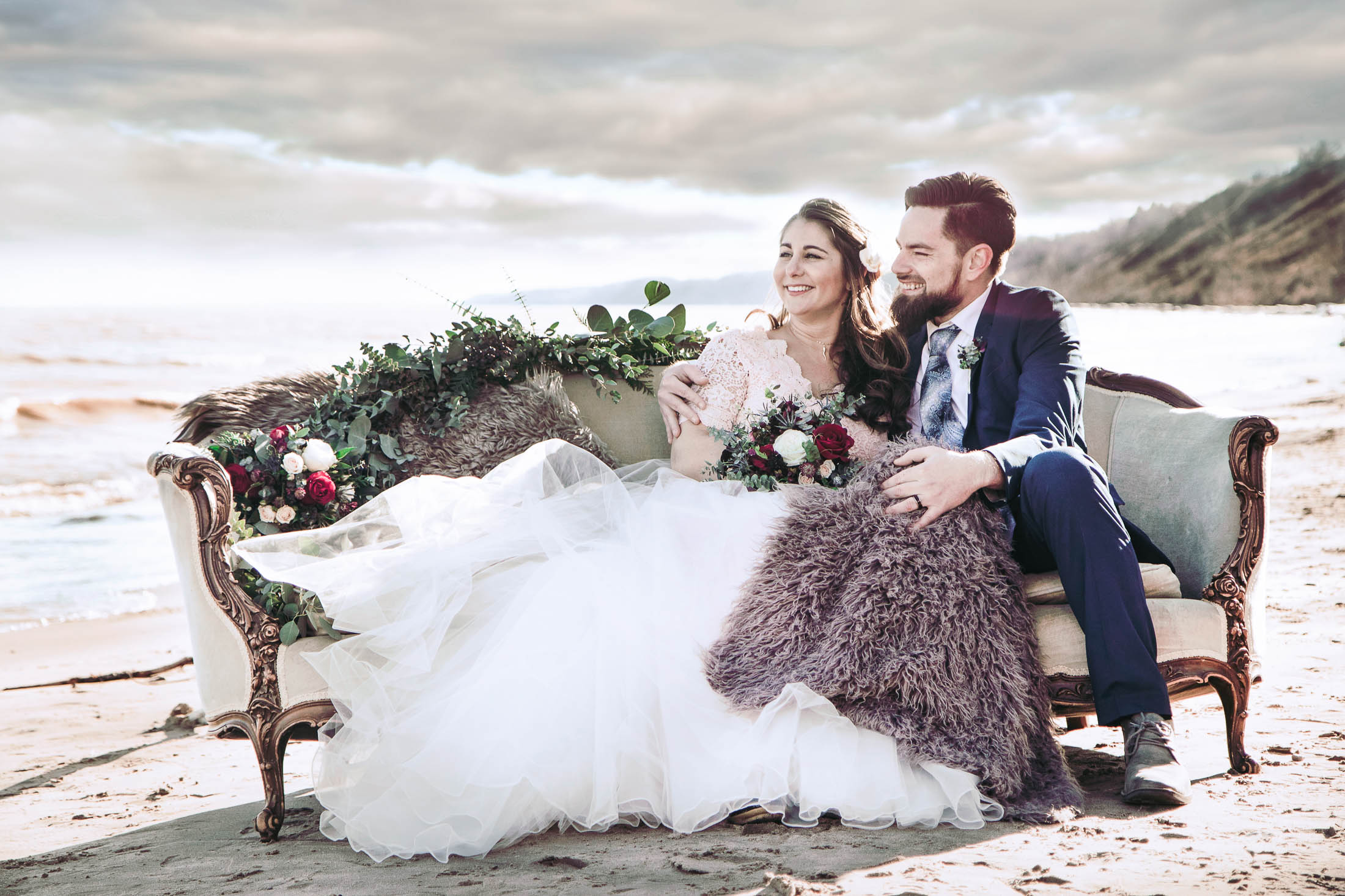 couple on the beach in wedding dress and suit
