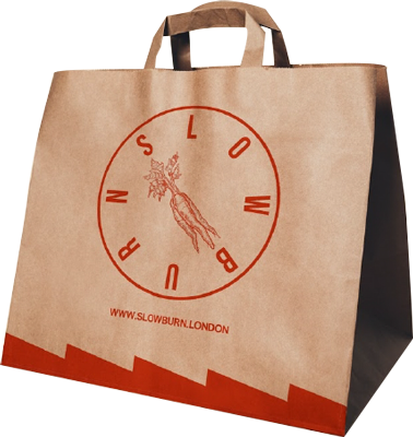 a brown paper bag with some red decorations on it