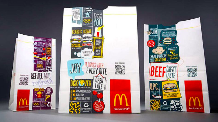 Mcdonald's take-away paper bags with printed QR codes on them