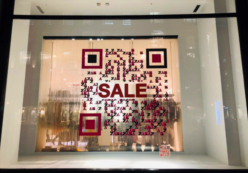 qr code sticker on a window of zara shop
