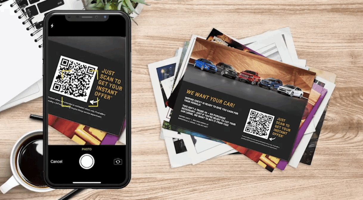 a mobile scanning a qr code on dealer inspire flyers