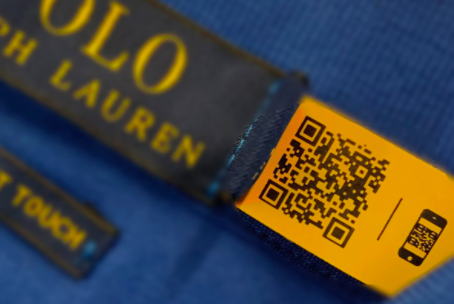 black qr code on an orange clothing tag of Polo Ralph Lauren