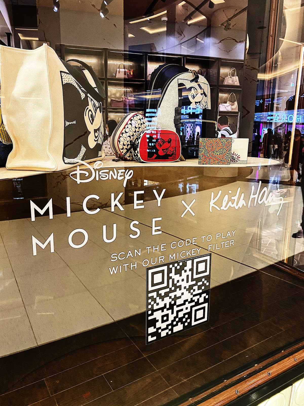 a qr code window sticker with Mickey Mouse filter in a shopping mall