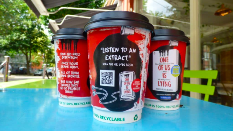 a qr code ad on coffee take away paper cup
