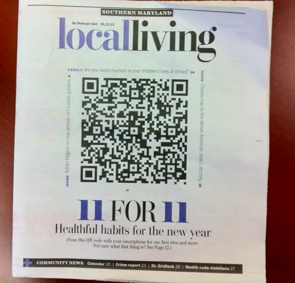 a huge qr code on a newspaper cover