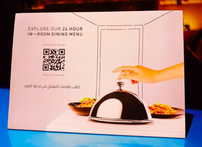 in-room dining qr code menu brochure in a hotel room