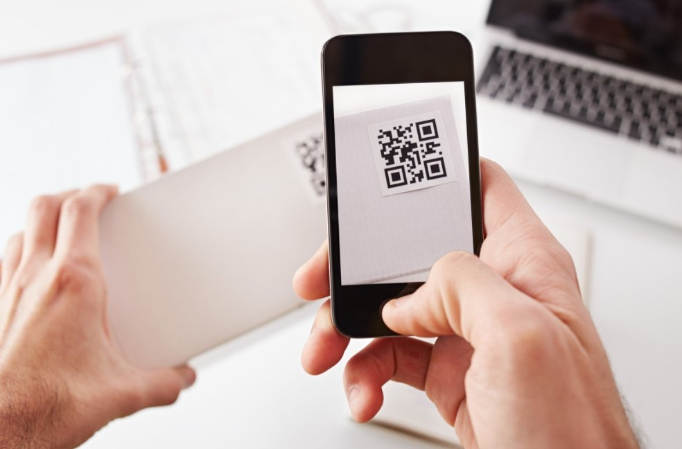 a person taking a photo of a QR code of a product