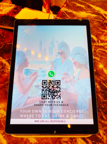 An ipad with a QR code for hotel concierge chat