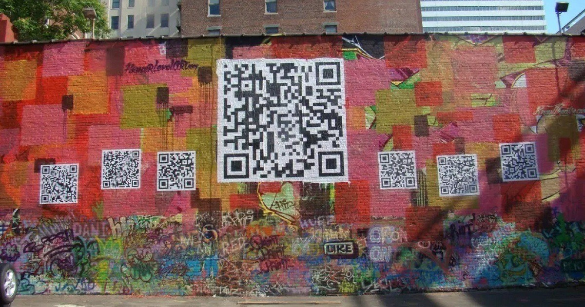 Street art black and white QR codes painted on a colourful brick wall