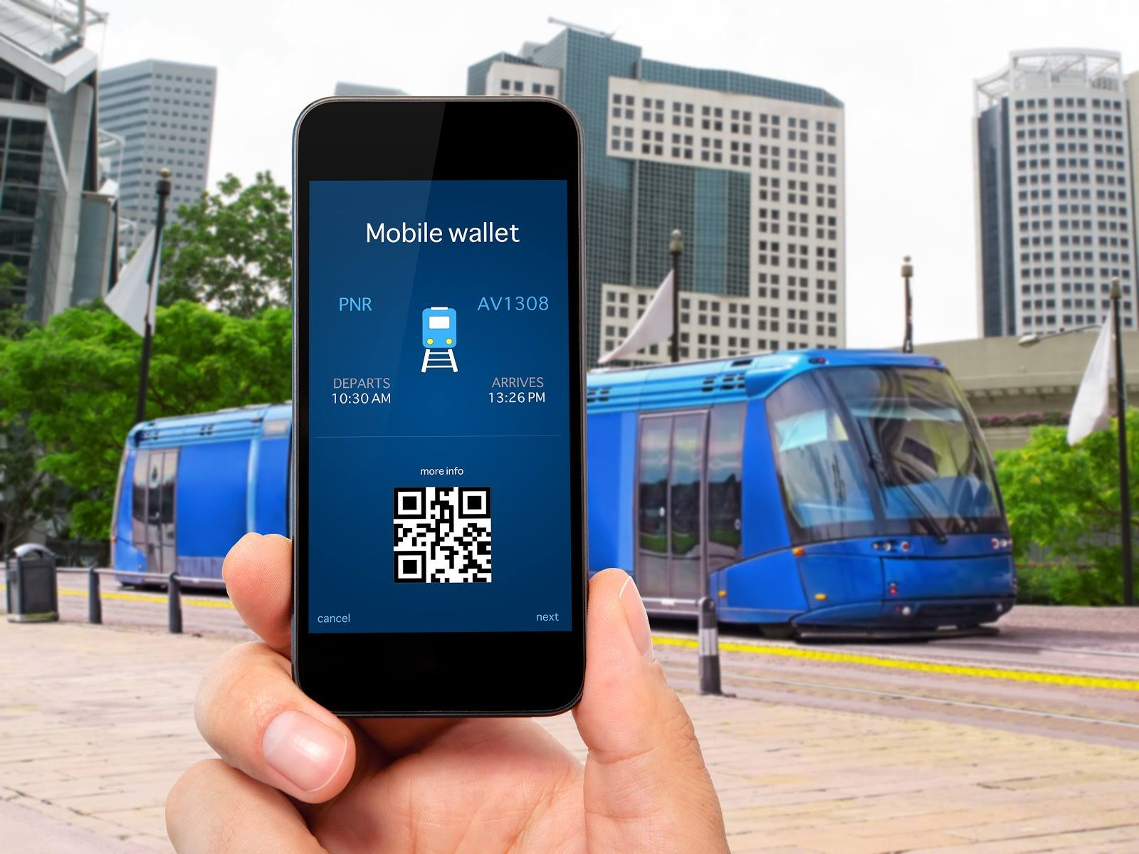 A phone with a QR code bus ticket in front of a blue bus