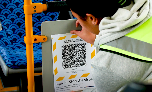 woman puts QR code on bus for covid tracking stop the virus