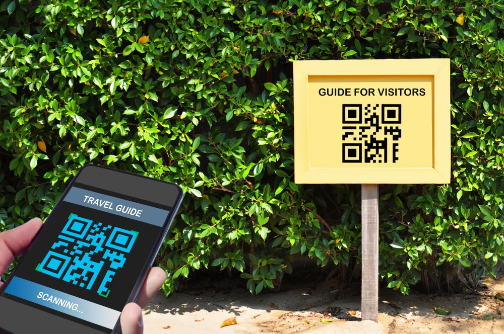 A phone scanning a guide for visitors QR code in the park