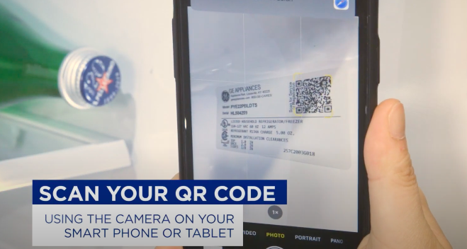 mobile phone scanning qr code label inside a refrigerator