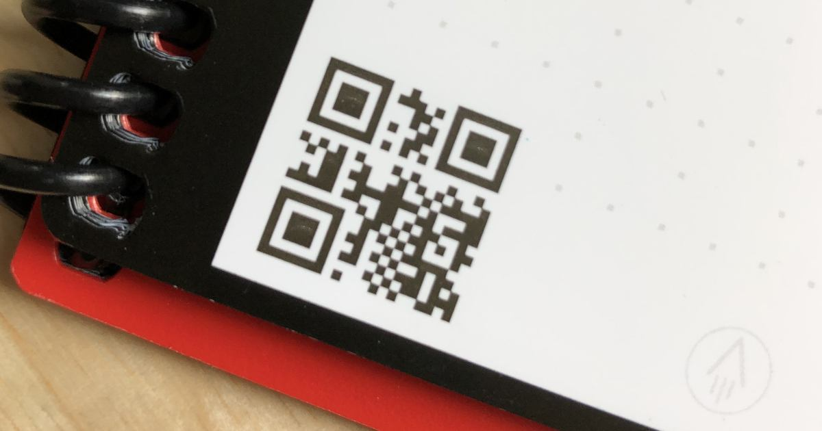 qr code printed in a corner of a notebook's page