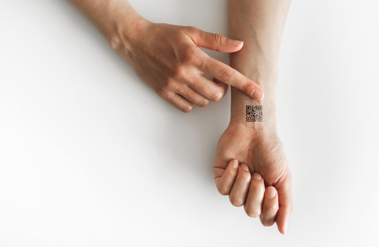 qr code tattoo on a wrist