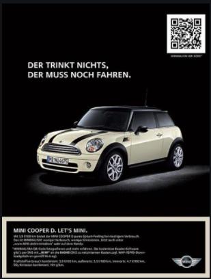 black magazine article with beige mini cooper and qr code