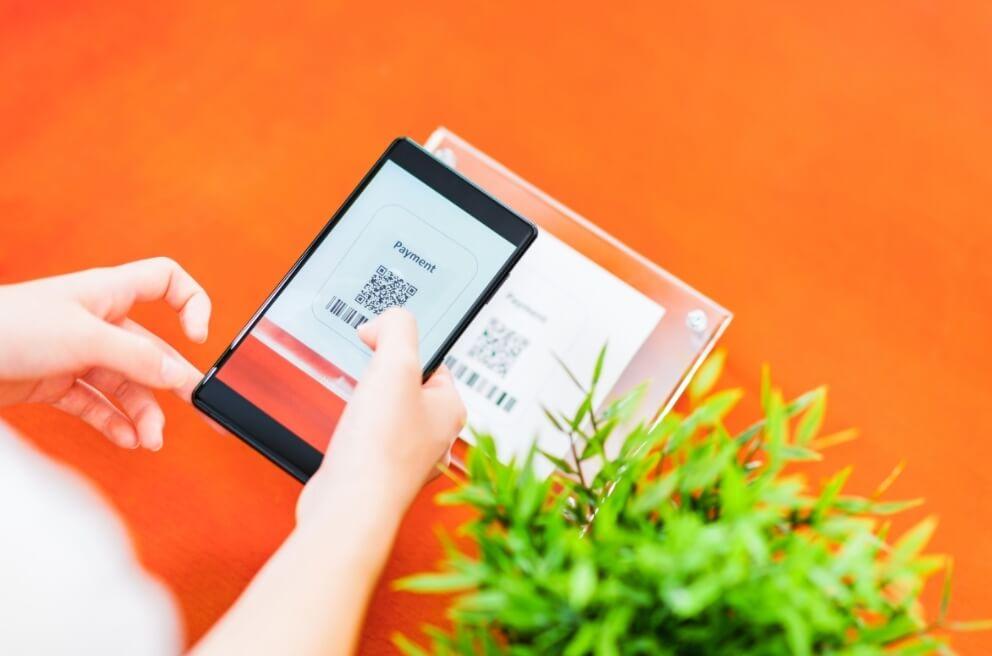 a woman sharing a qr code via smartphone