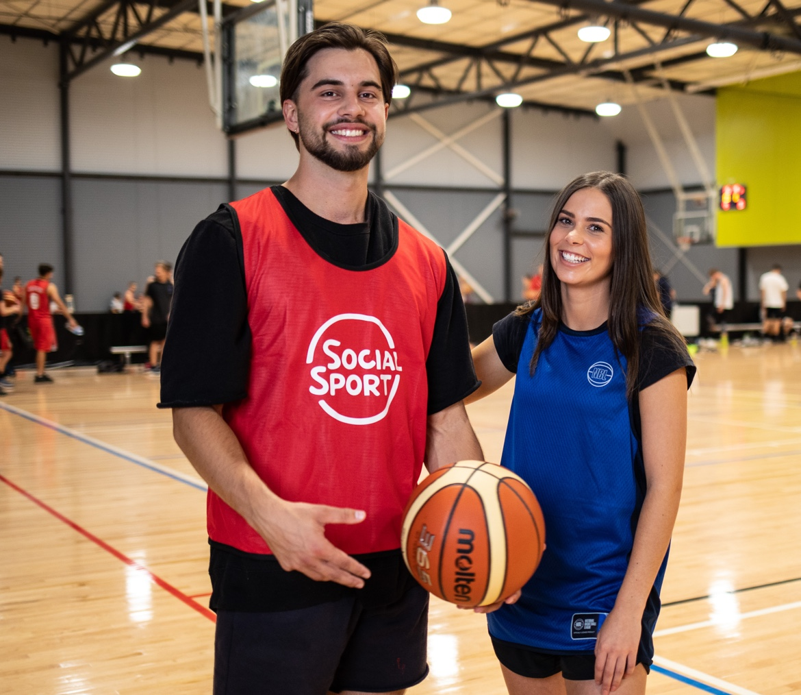 A male and female basketball player