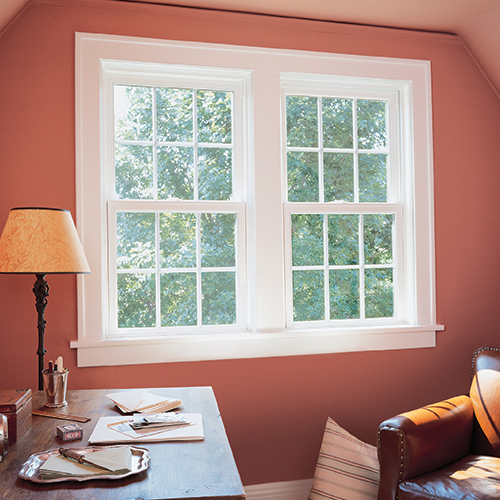 Double hung windows in home office.