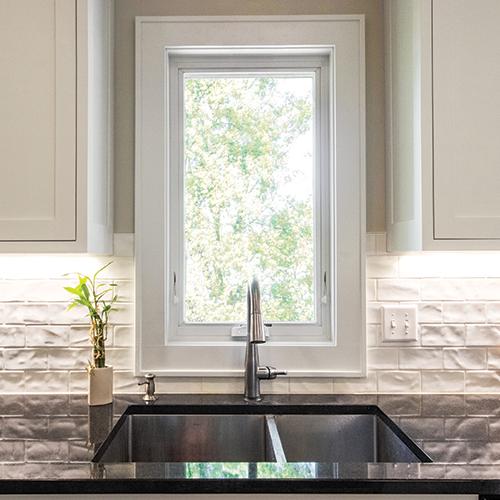 Awning window above kitchen sink.