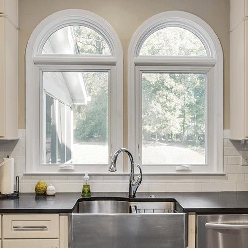 2 round top windows above kitchen sink.