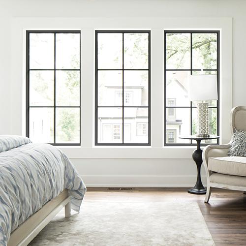 3 casement windows in bedroom.