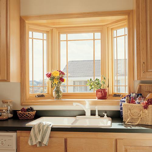 Bay window above kitchen sink.
