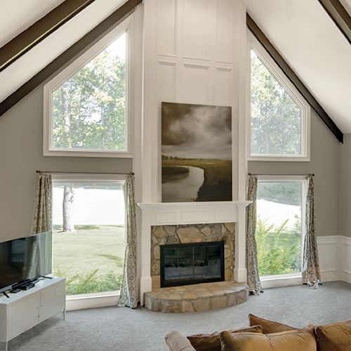 Interior view of fireplace framed by rectangle and polygon windows.