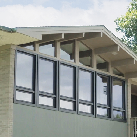 A frame style home with rectangle and polygon windows exterior view.