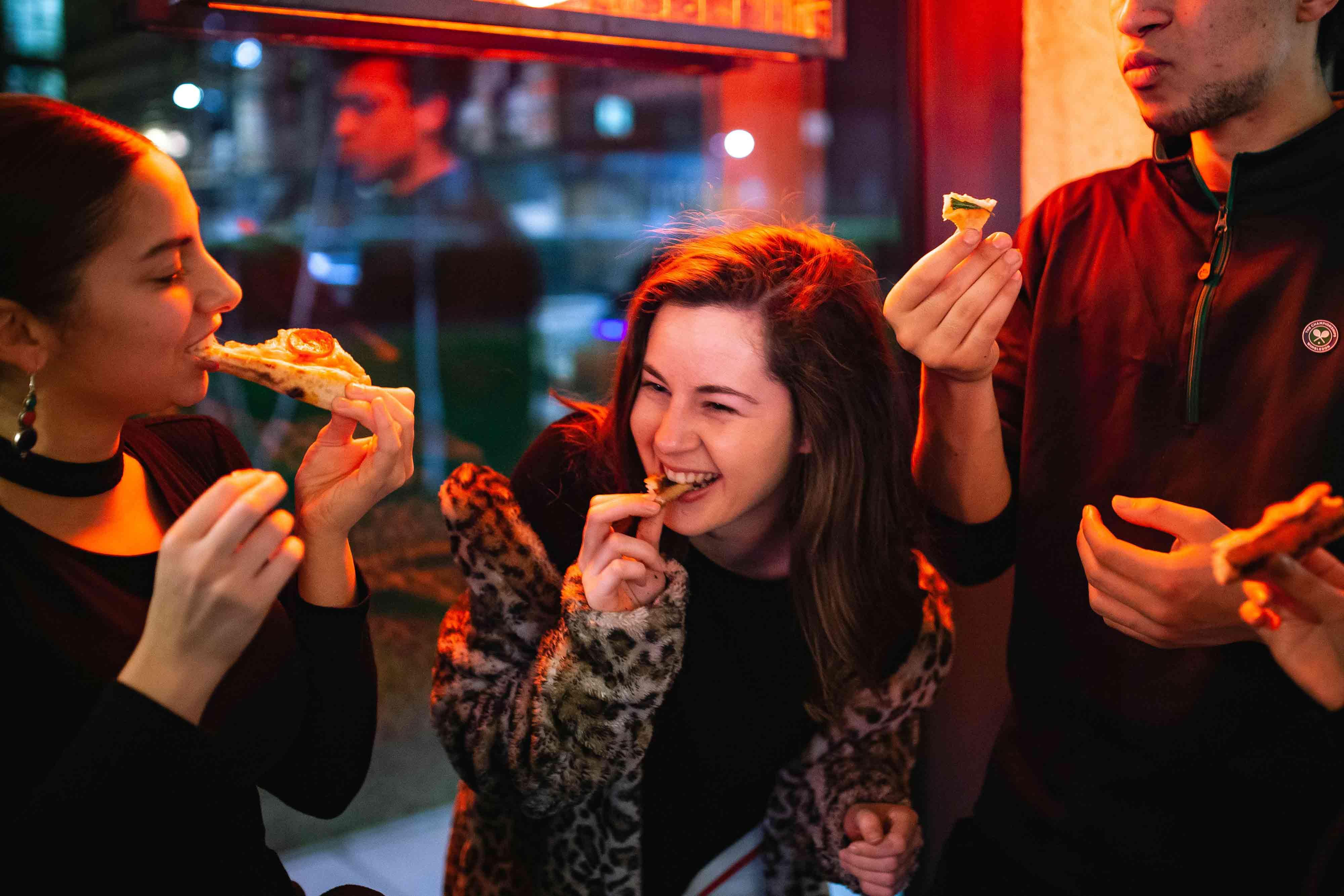 People loving pizza