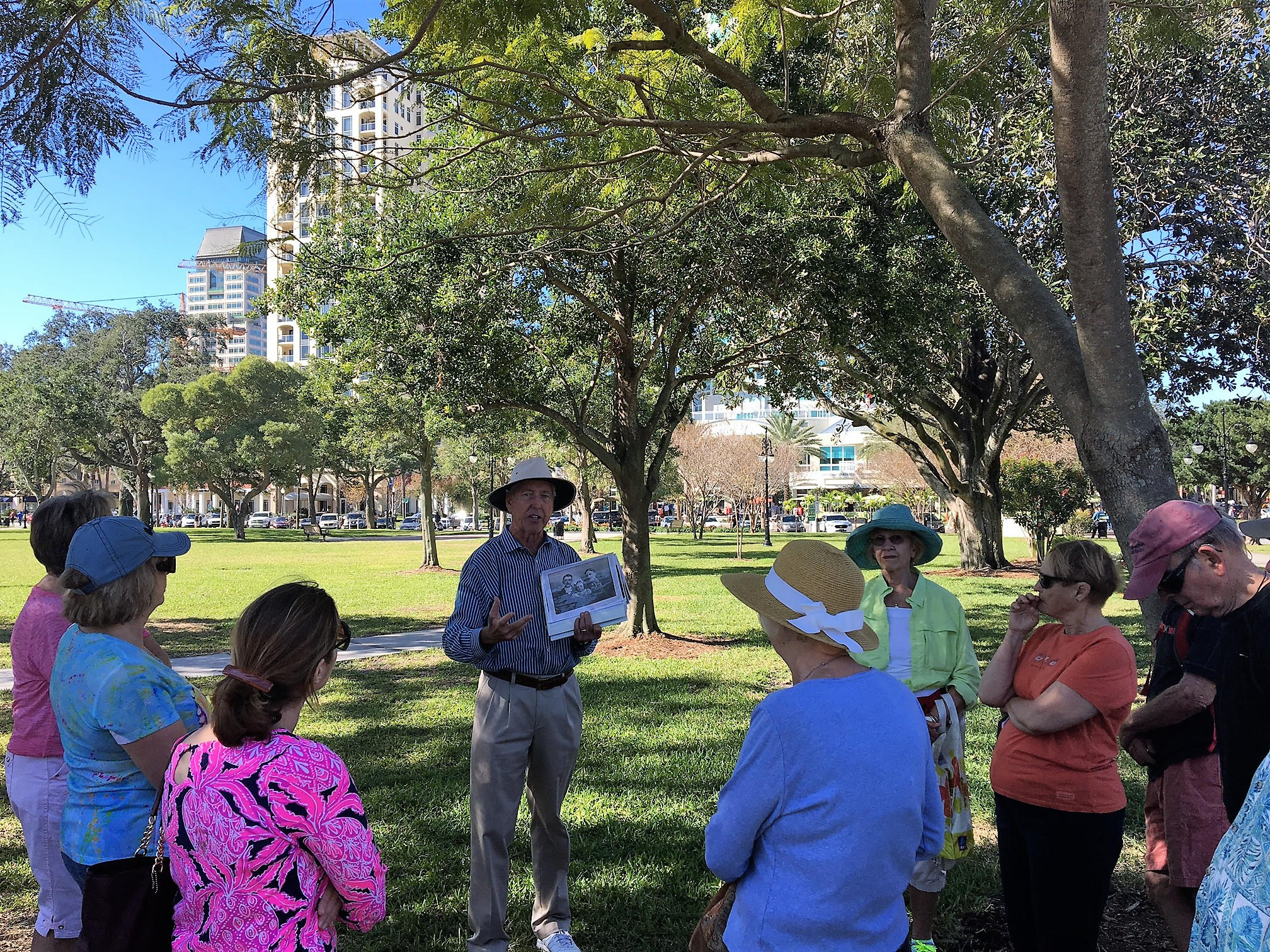 man giving private group tour downtown