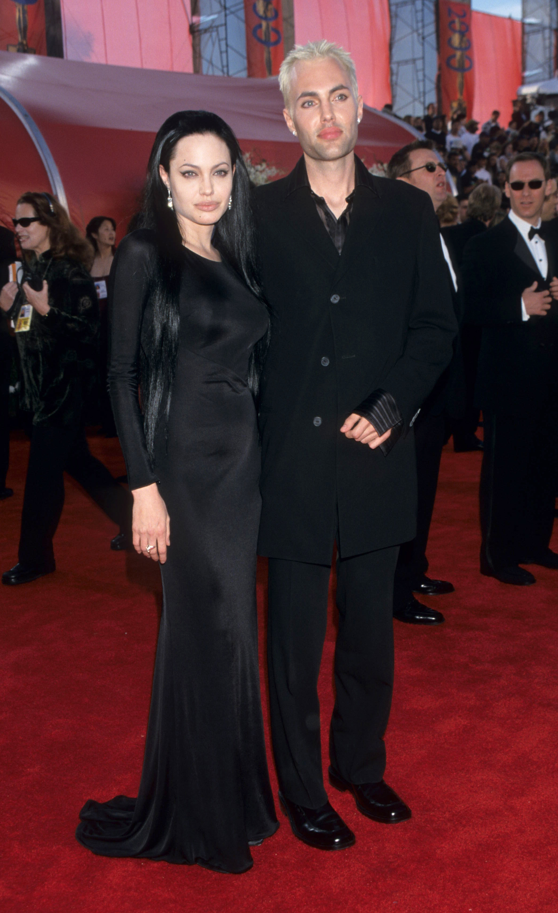 angelina jolie in a goth dress and dark hair on the red carpet