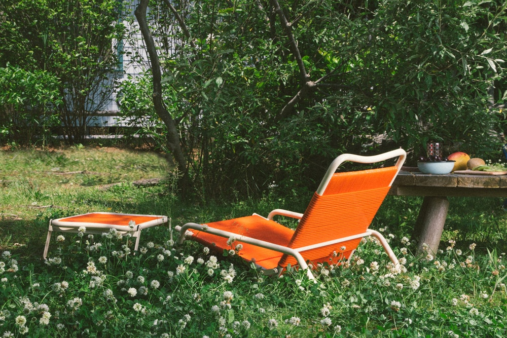 Image may contain Furniture Chair Plant Grass and Outdoors