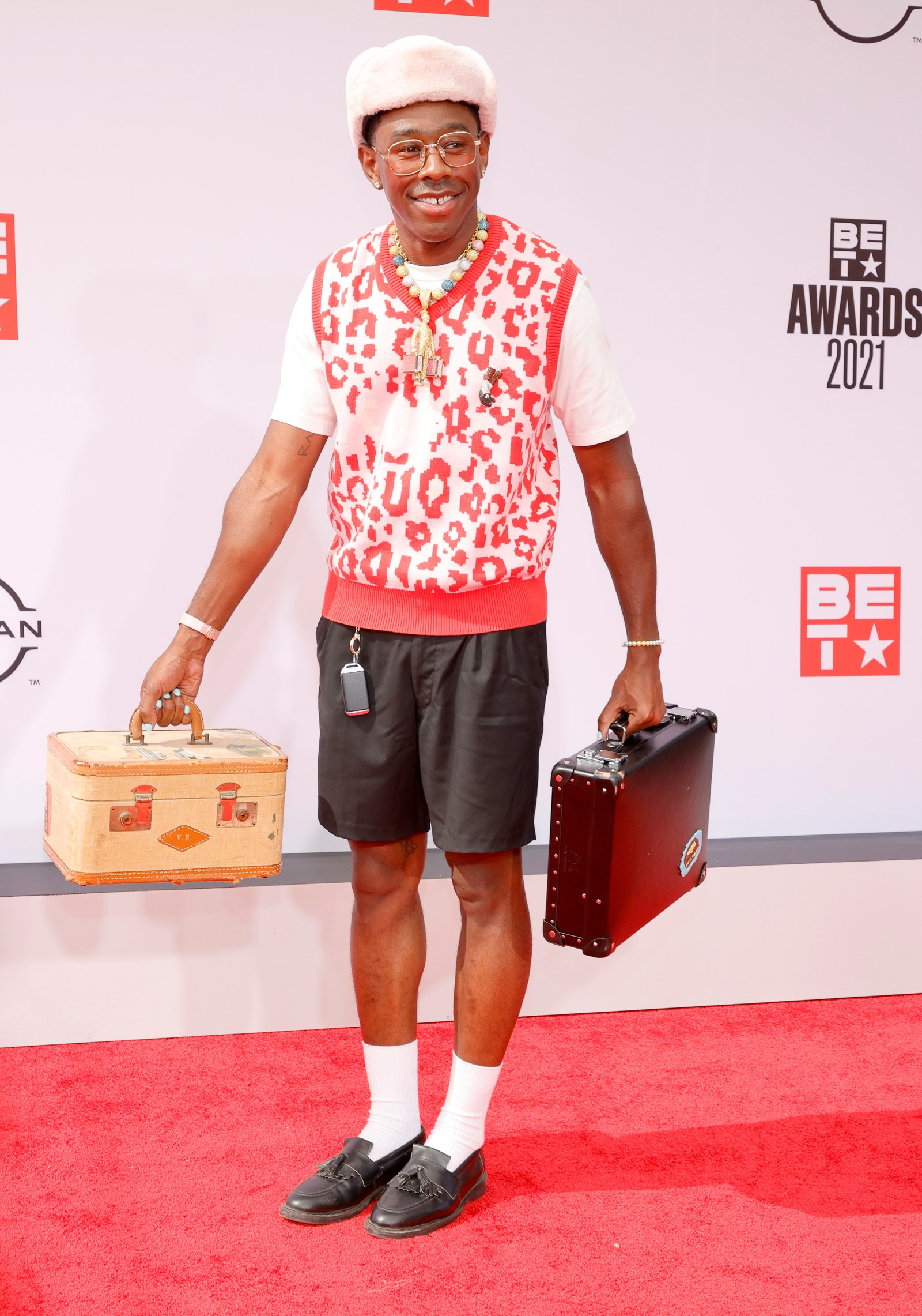 Image may contain Human Person Clothing Apparel Shorts Tyler The Creator Footwear Shoe and Bag