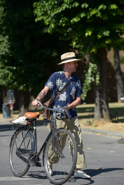Image may contain Wheel Machine Transportation Vehicle Bicycle Bike Human Person Hat Clothing and Apparel