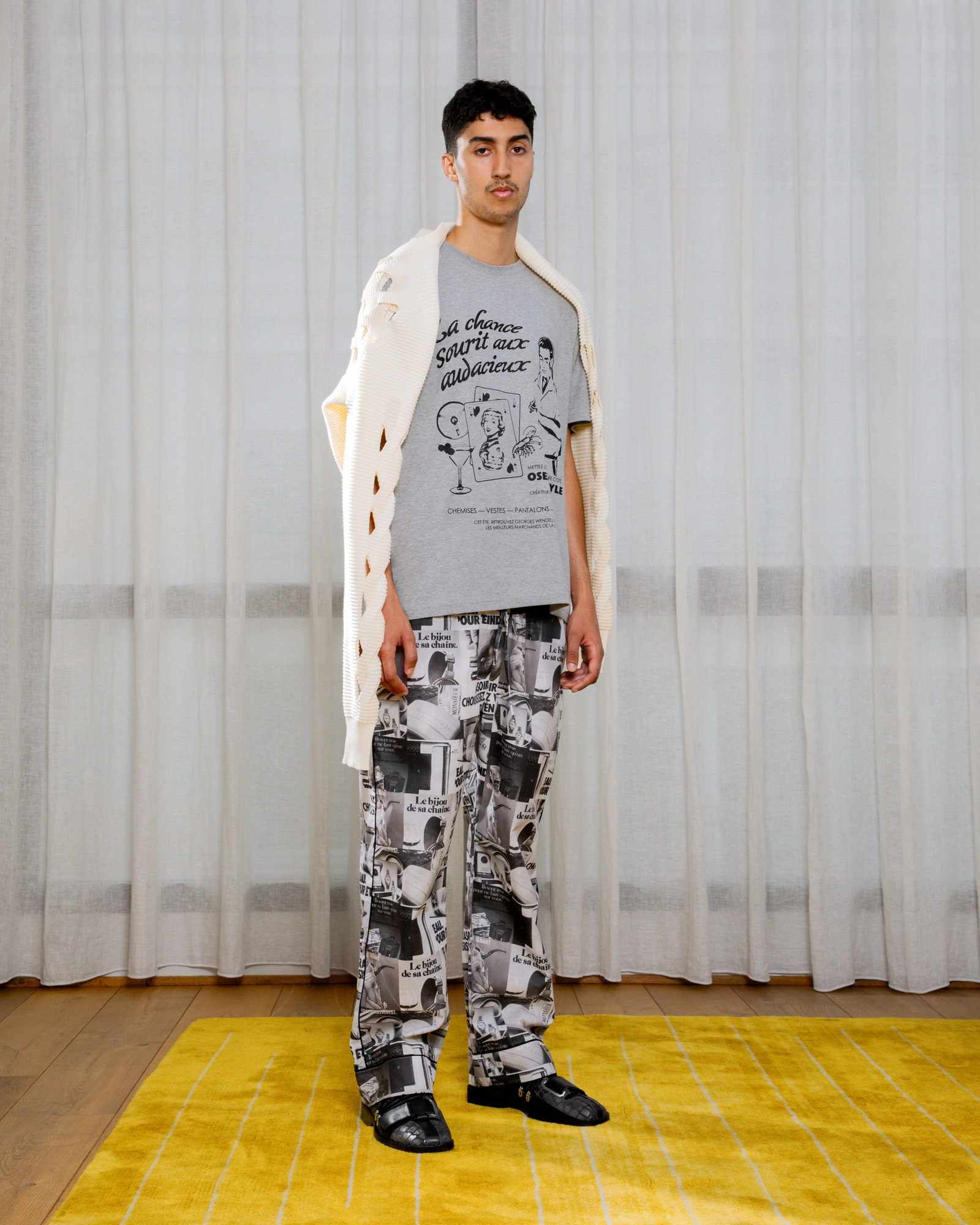 Image may contain Clothing Apparel Flooring Human Person Floor Pants and Wood
