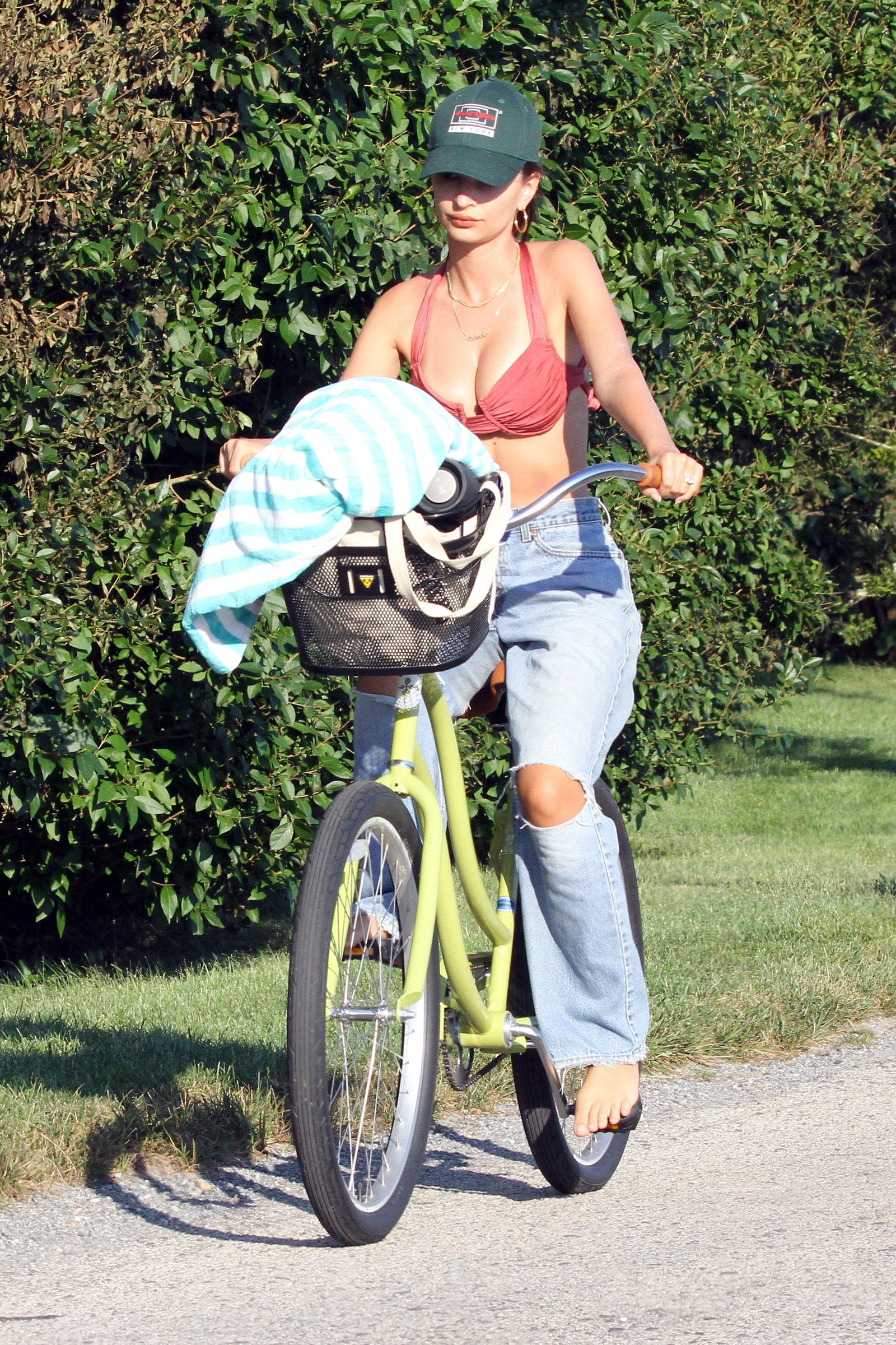 Are Baggy Jeans the Best Beach CoverUp Emily Ratajkowski Bella Hadid and Kaia Gerber Say Yes