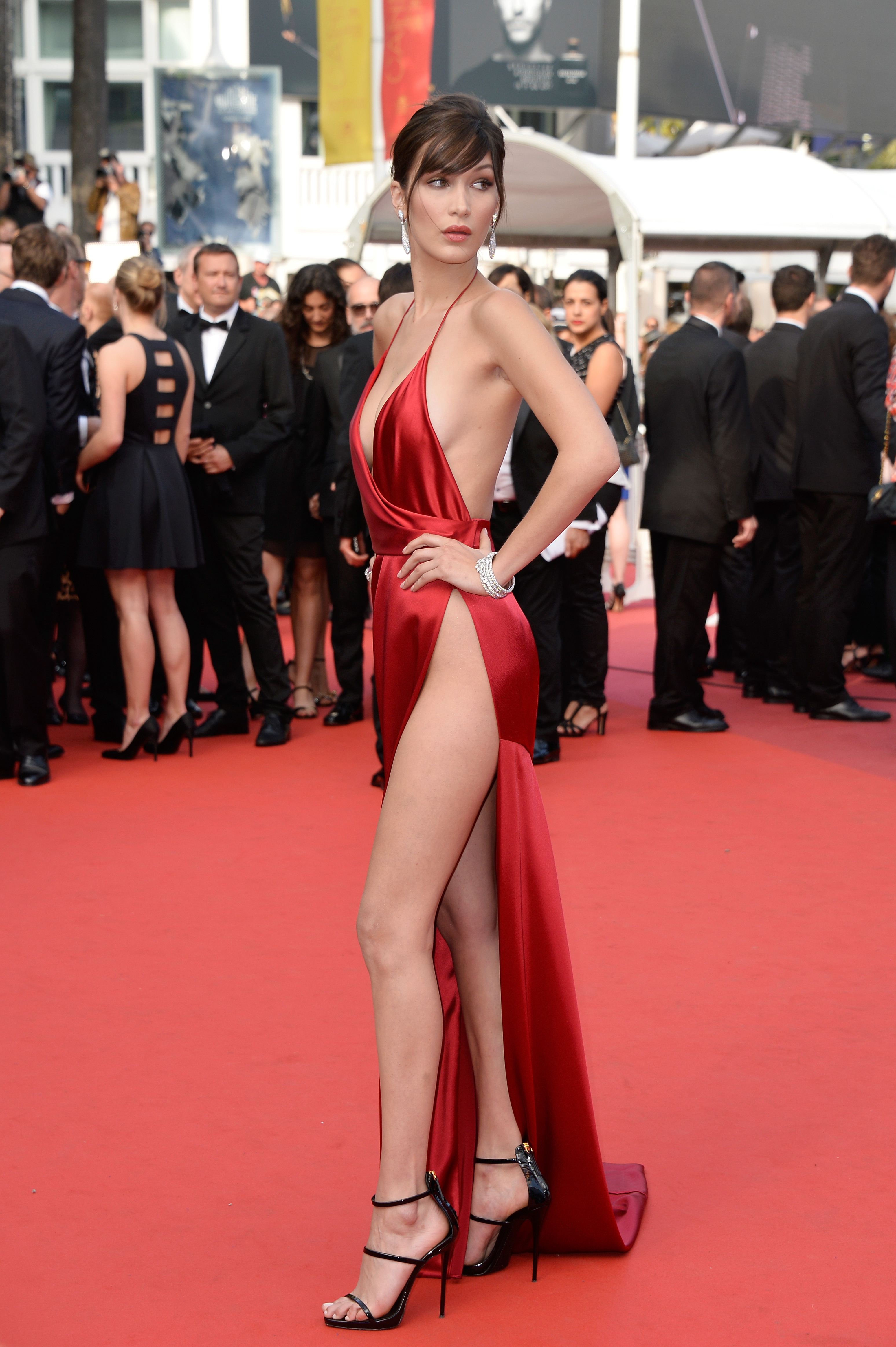 bella hadid in a red dress on the red carpet at cannes 2016