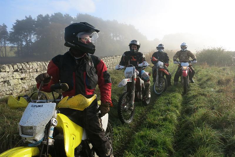Bikers riding a British trail